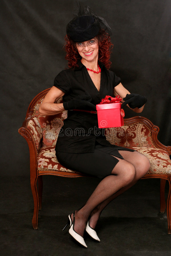 A Beautiful Middle-aged Woman With A Red Gift Stock Photography