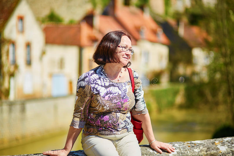 Beautiful middle aged woman in Semur-en-Auxois. Burgundy, France stock image