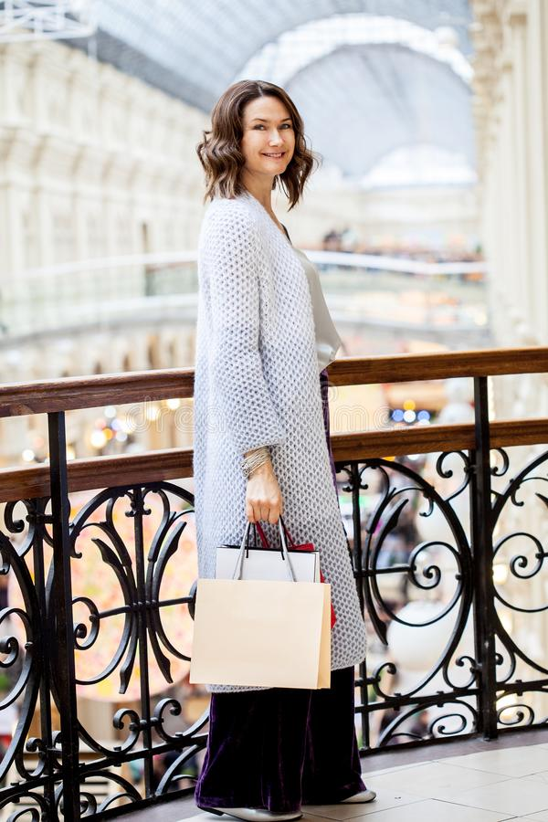 Beautiful middle-aged woman with shopping bags royalty free stock images