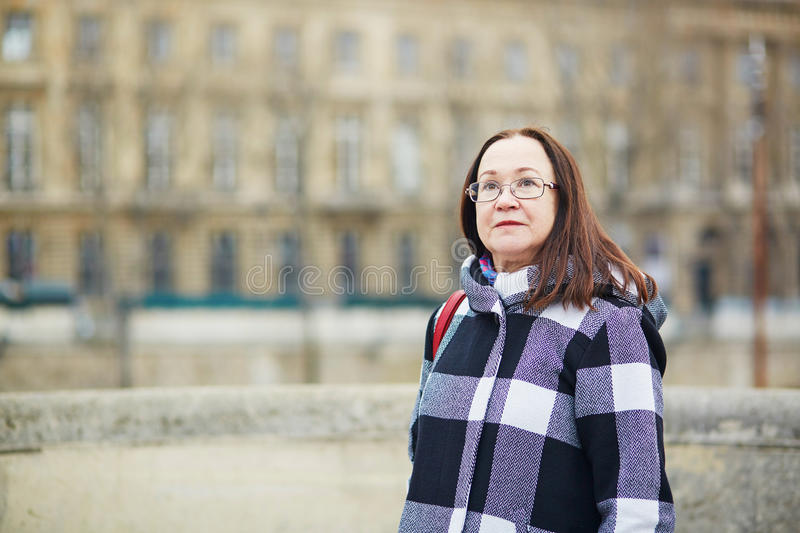Beautiful middle aged woman walking in Paris. On a spring day stock image