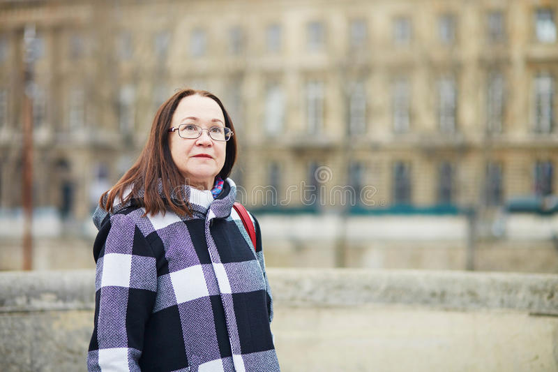 Beautiful middle aged woman walking in Paris stock images