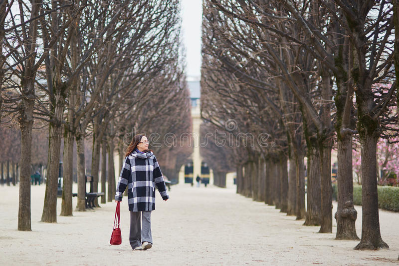 Beautiful middle aged woman walking in Parisian park. On a spring day stock images