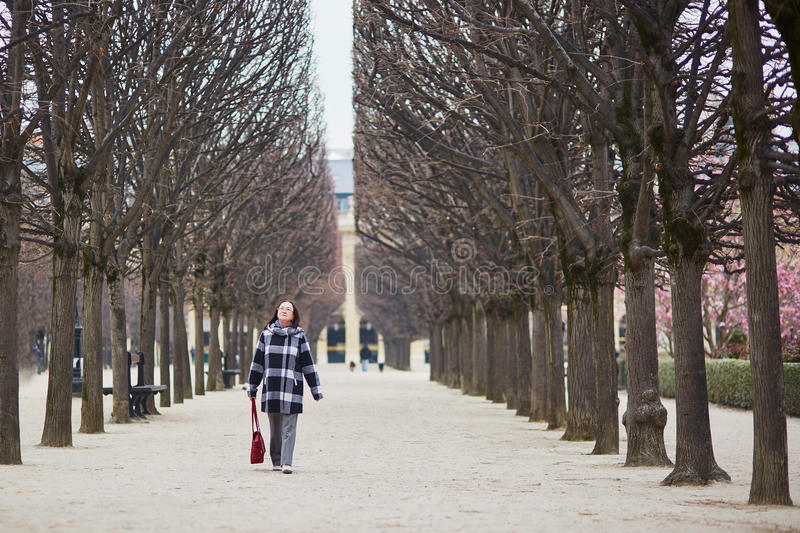 Beautiful middle aged woman walking in Parisian park. On a spring day stock photos