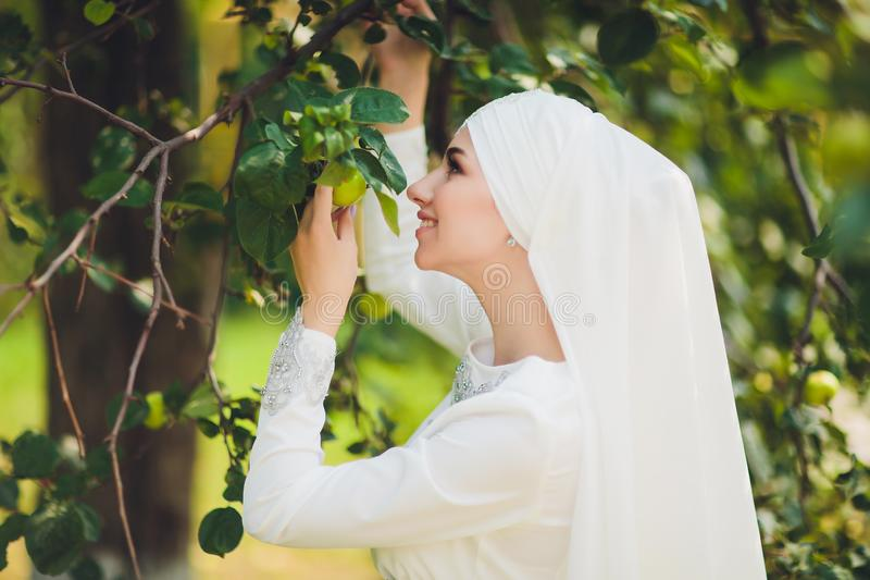Beautiful Middle Eastern Arabic girl having happy time in nature. stock photo