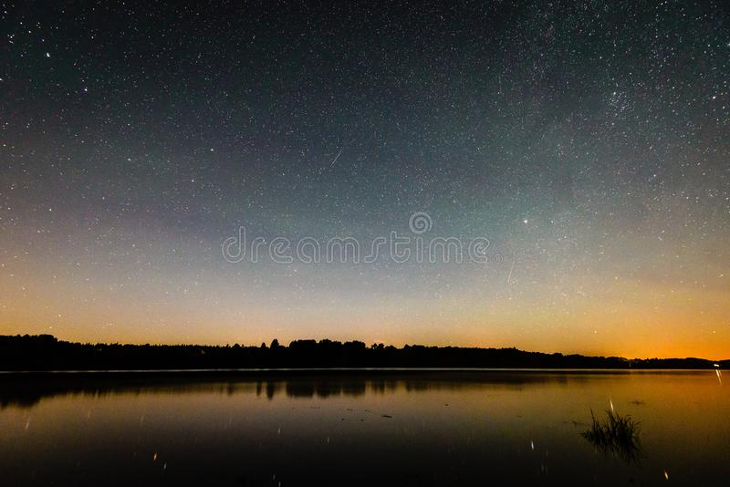 Beautiful milky way galaxy on a night sky and silhouette of tree stock images