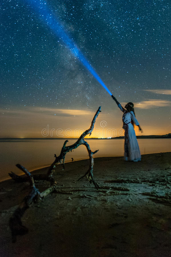 Beautiful Milky Way with standing woman. stock photo