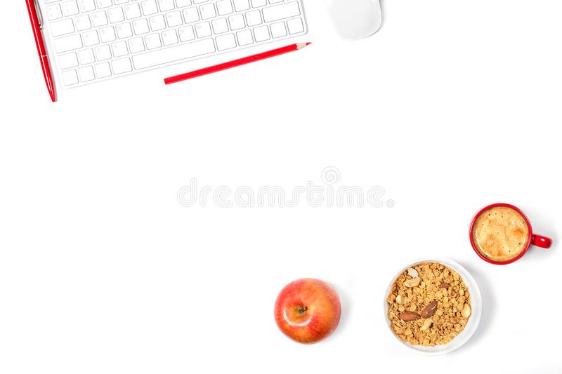 Beautiful minimal mockup. White modern keyboard, mouse, pencil, pen, plate with granola, small red cup of coffee on white backgrou royalty free stock photos