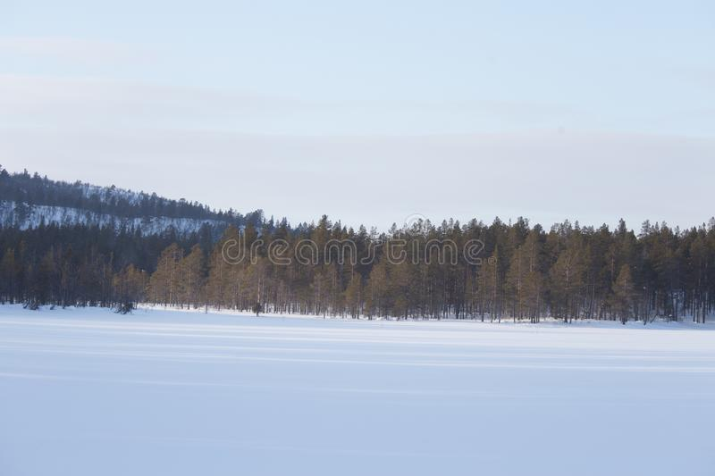 A beautiful minimalist landscape of a frozen lake in central Norway. stock photography