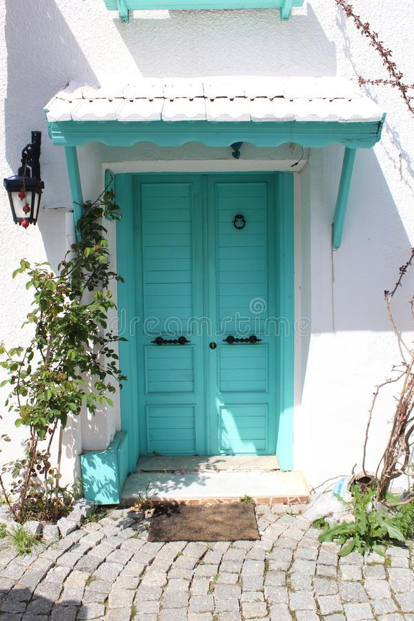 Beautiful mint door and white wall from izmir, Turkey. Beautiful mint door white wall izmir turkey ancient history tourism visit touristic freshness summer mood stock photos