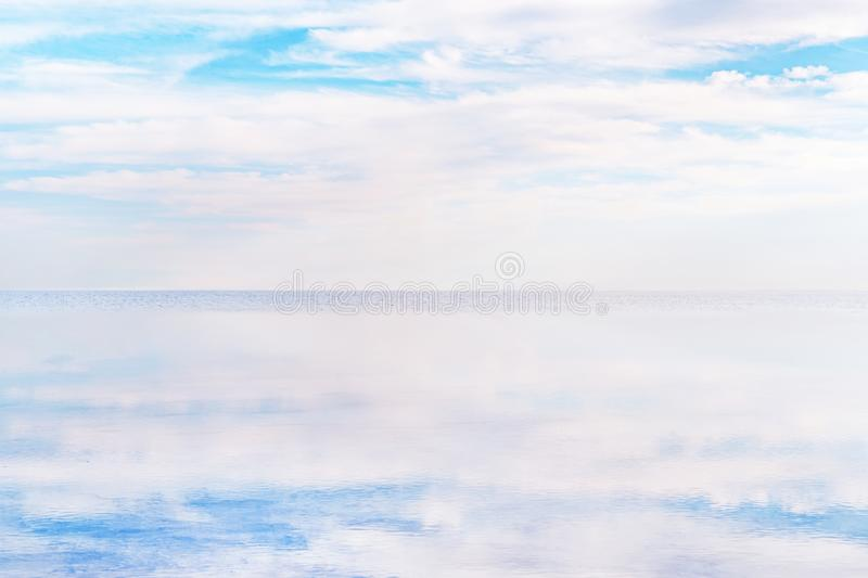 beautiful calm landscape. Ecologically clean place. Beautiful mirror reflection on blue sky and cloud. Water reflection of clouds stock photography