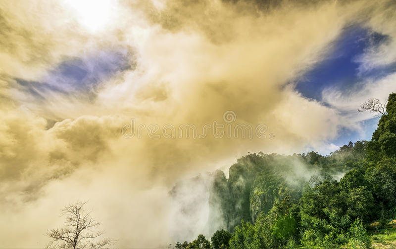 Beautiful misty view of Pillar Rocks of Kodaikanal, Tamil Nadu,. Pillar Rocks of Kodaikanal are set of three giant rock pillars which stand 122 metres (400 ft) stock photo