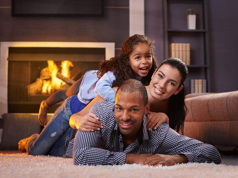 Beautiful mixed race family at home smiling royalty free stock images