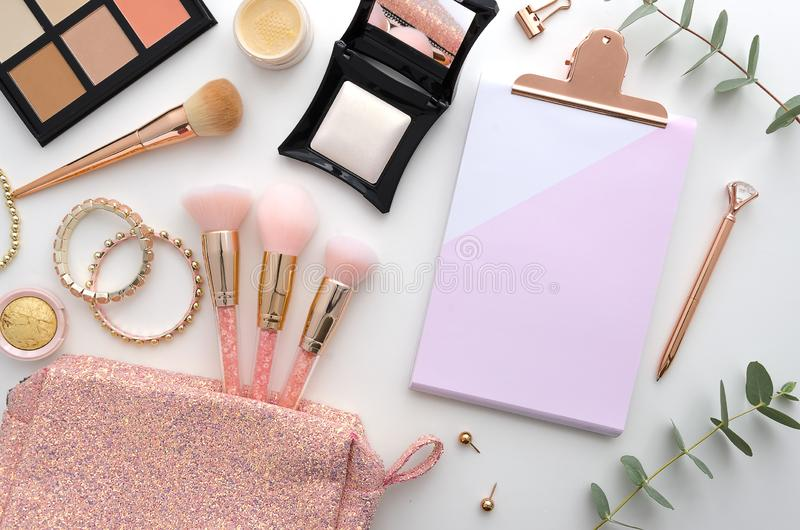 Beautiful mockup flat lay design for blogging workplace background. Cosmetics, makeup brushes, cosmetic bag, palette royalty free stock photography