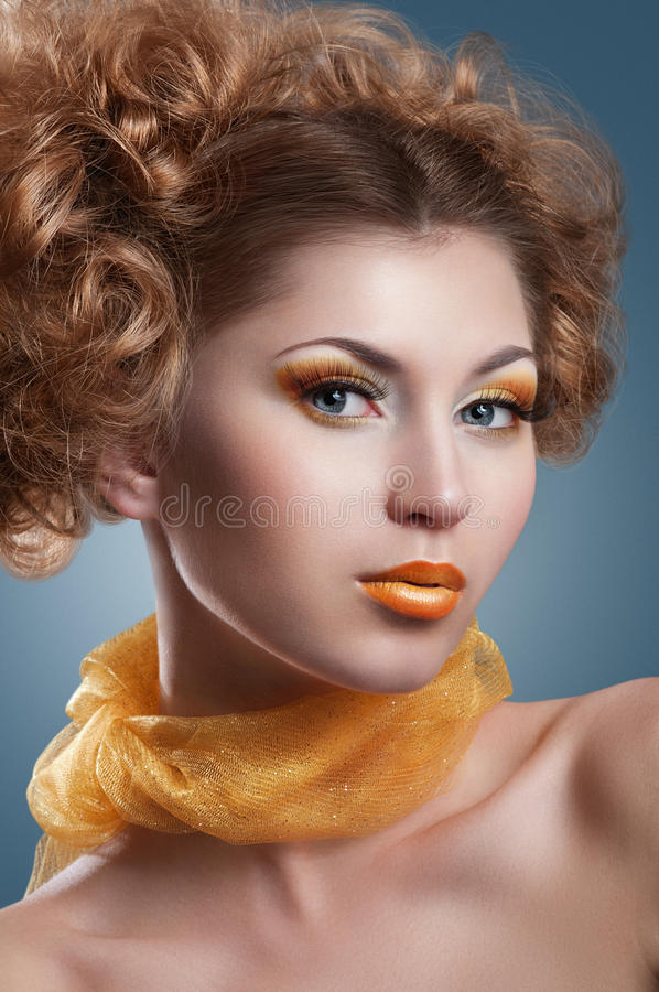 Beautiful model. Beautiful woman with bright creative yellow makeup and curly hairstyle stock images