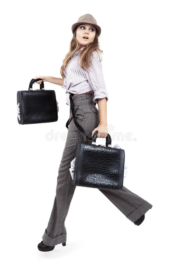 Beautiful model with bags filled with money next to white background stock photo