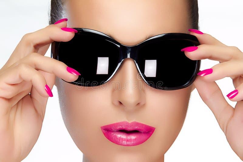 Beautiful Model in Black Fashion Sunglasses. Bright Makeup and M stock photo