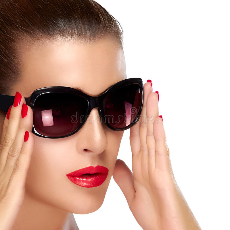 Beautiful Model in Black Fashion Sunglasses. Bright Makeup and M. Beautiful fashion model girl with stylish oversized black sunglasses. Bright makeup and royalty free stock image
