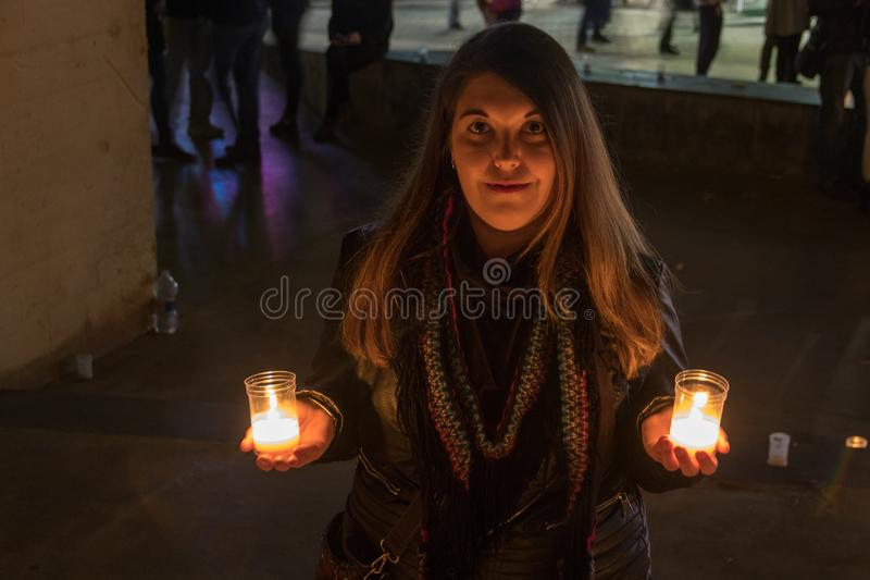 Model with black jacket in night photo with candles stock image