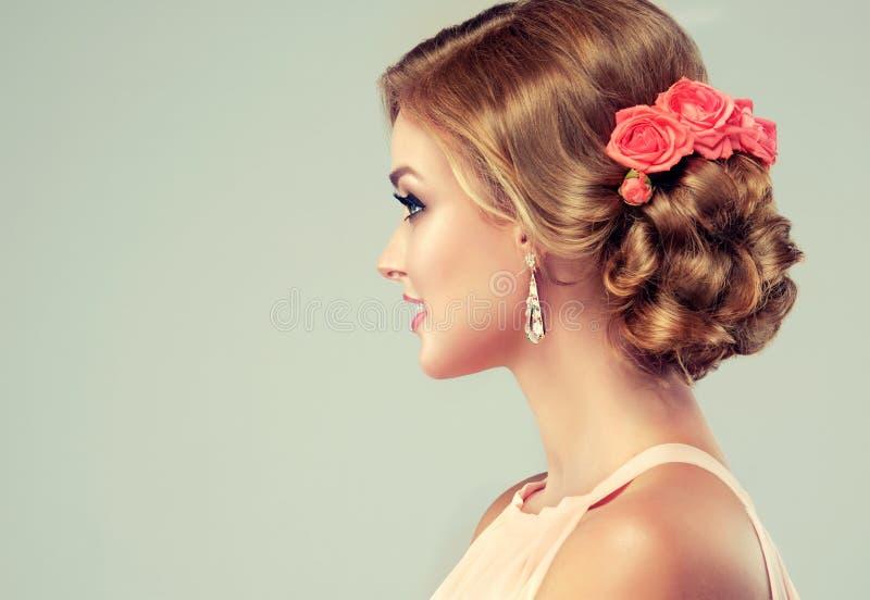 Beautiful model with elegant wedding hairstyle. stock images