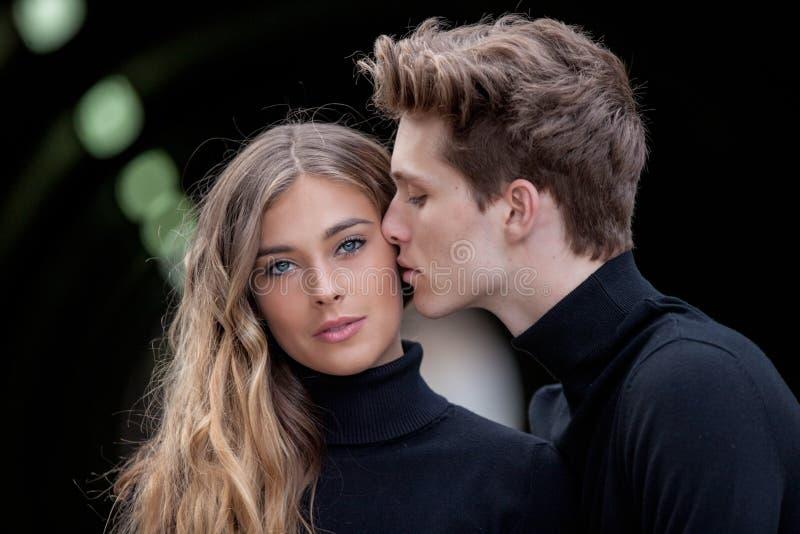 Beautiful couple kissing royalty free stock photo