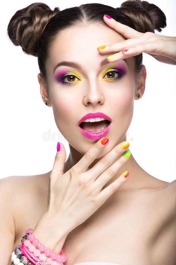 Beautiful model girl with bright colored makeup and nail polish in the summer image. Beauty face. Short colored nails. Picture taken in the studio on a white stock photos