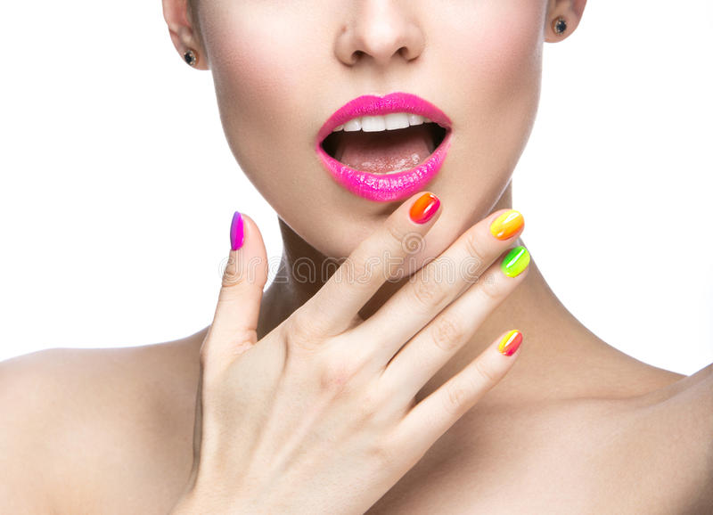 Beautiful model girl with bright colored makeup and nail polish in the summer image. Beauty face. Short colored nails. stock images