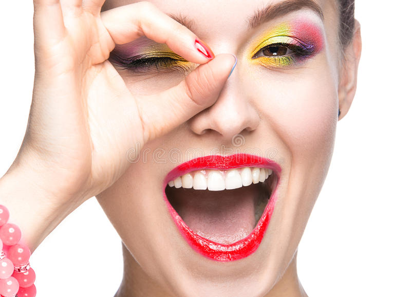 Beautiful model girl with bright colored makeup and nail polish in the summer image. Beauty face. Short colored nails. stock photo