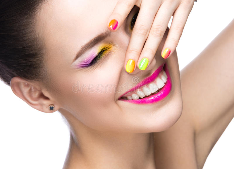 Beautiful model girl with bright colored makeup and nail polish in the summer image. Beauty face. Short colored nails. stock image