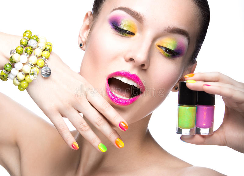 Beautiful model girl with bright colored makeup and nail polish in the summer image. Beauty face. Short colored nails. Picture taken in the studio on a white royalty free stock photography
