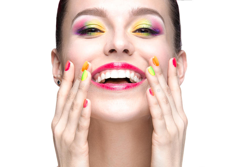 Beautiful model girl with bright colored makeup and nail polish in the summer image. Beauty face. Short colored nails. Picture taken in the studio on a white royalty free stock image