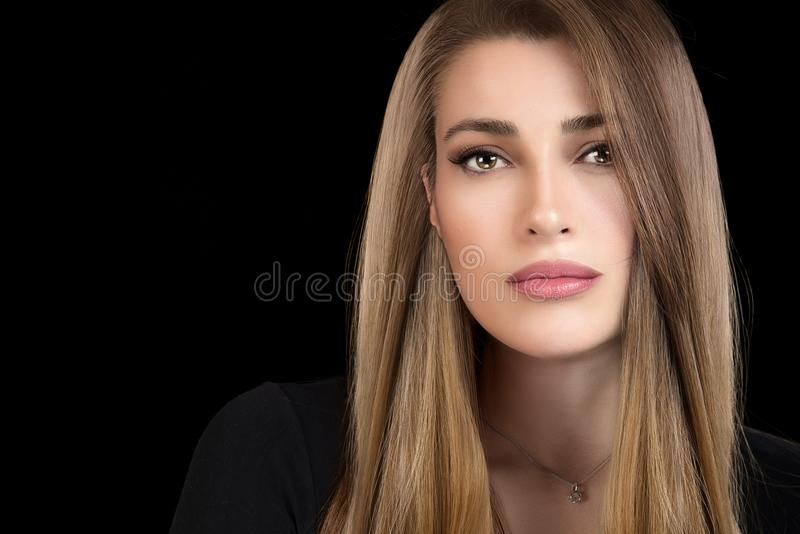 Beautiful model girl with healthy long hair. Hair coloring technique. Beautiful model girl with shiny and healthy long hair with multi highlights hairstyle royalty free stock photo