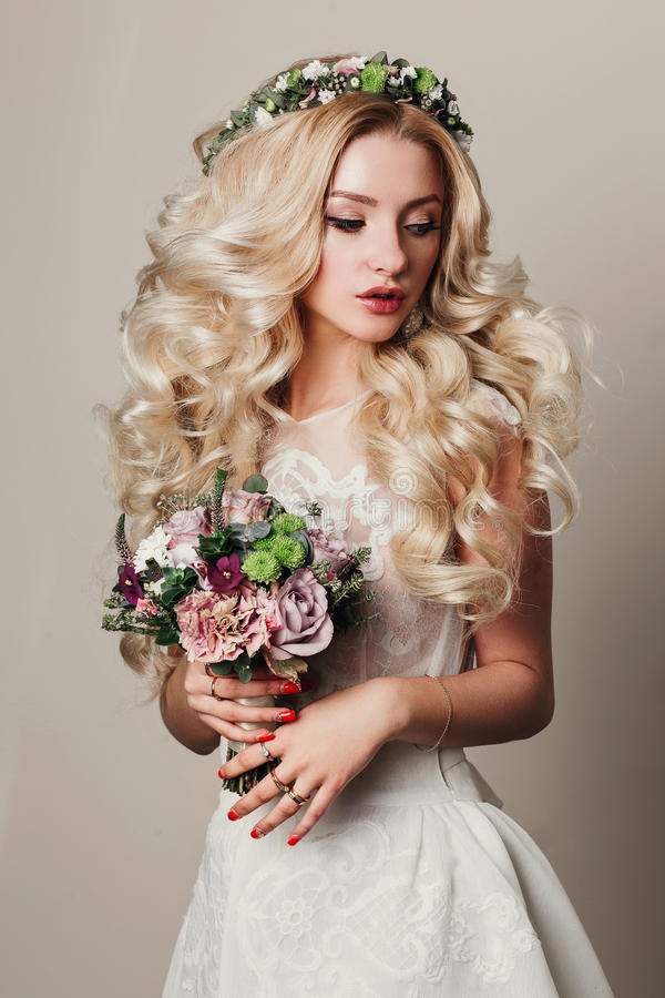 Beautiful model girl with long curly blond hair royalty free stock photo