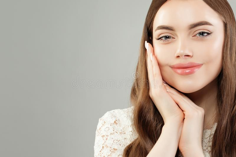 Beautiful model girl portrait. Cute woman with clear skin, skincare and facial treatment concept stock images