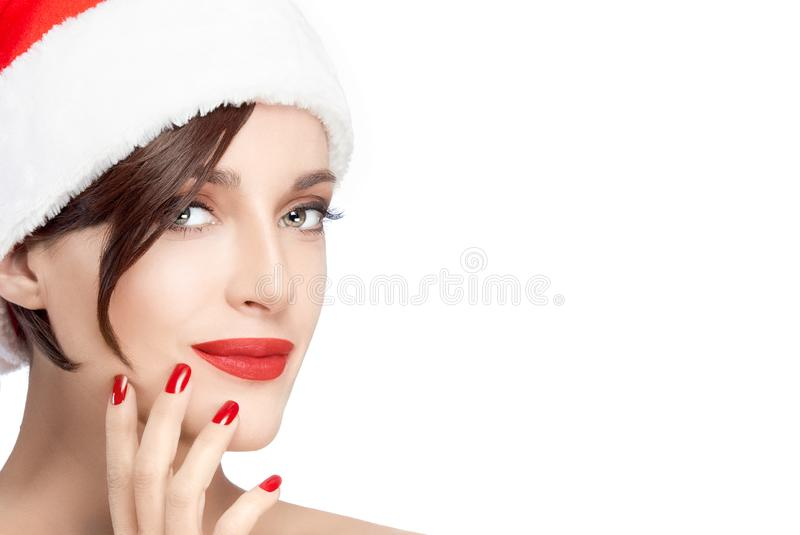 Beautiful model girl in a red Santa hat for Christmas royalty free stock photo