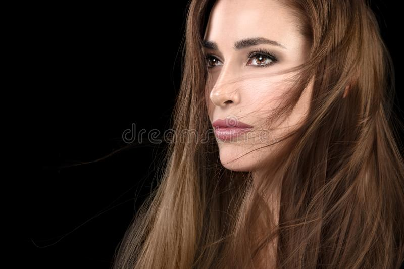Beautiful model girl with tousled hair style. Beautiful model girl with tousled hair style in a healthy long hair. Multi highlights color technique. Care and stock photos