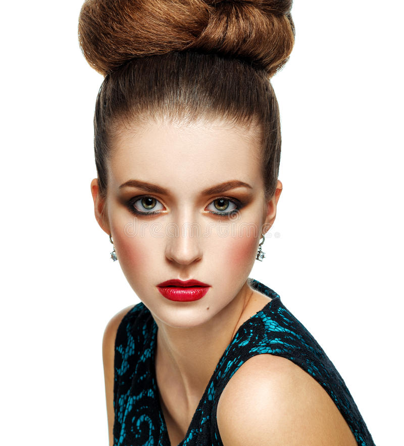 Beautiful Model Girl with Updo hairstyle and stylish makeup. Beauty woman with glamour hairdo hair style and accessories. Red lips and blue dress royalty free stock image