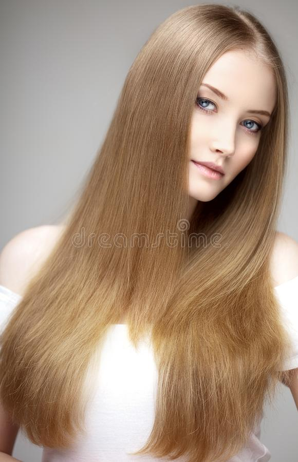Beautiful model with healthy shiny long hair. Beauty luxurious h. Airstyle by stylist in salon hair care royalty free stock photo