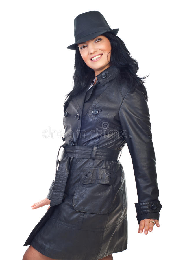 Beautiful model in leather jacket and hat stock images