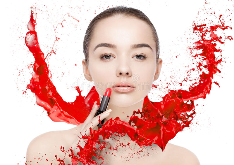 Beautiful model with lipstick tube paint splashes stock photo