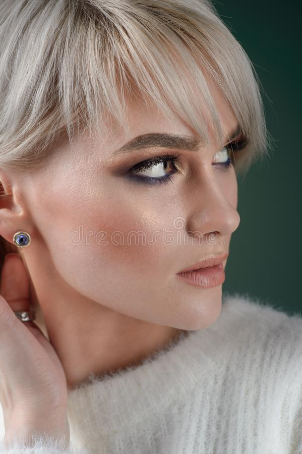 Beautiful model with luxurious silver jewelry. Woman wears silver jewelry royalty free stock photos