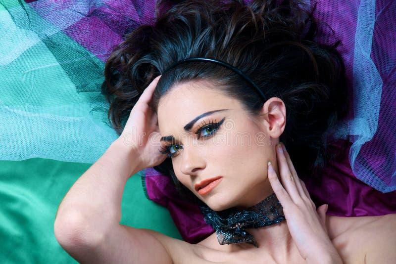Beautiful Model lying on floor royalty free stock photo