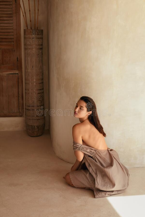 Beautiful Model. Portrait Of Seductive Tanned Woman With Perfect Body And Smooth Skin. View From Back Of Young Brunette. royalty free stock photo
