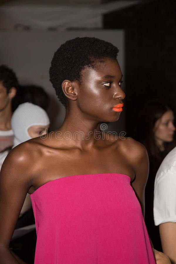 Beautiful model posing in the backstage. MILAN, ITALY - JUNE 17: Beautiful model poses in the backstage just before Edithmarcel show during Milan Men`s Fashion stock photo