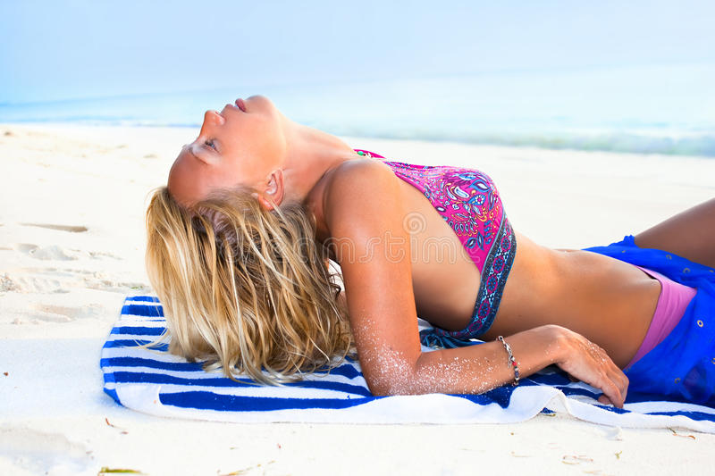 Download A Beautiful Model Relaxing On A Tropical Beach Stock Image - Image: 13901917