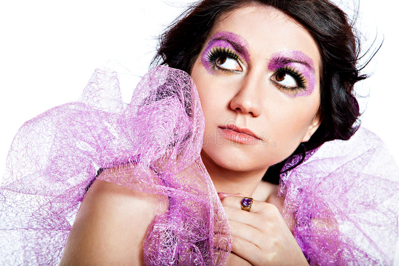 Beautiful model with violet glitter eye-make-up royalty free stock photo