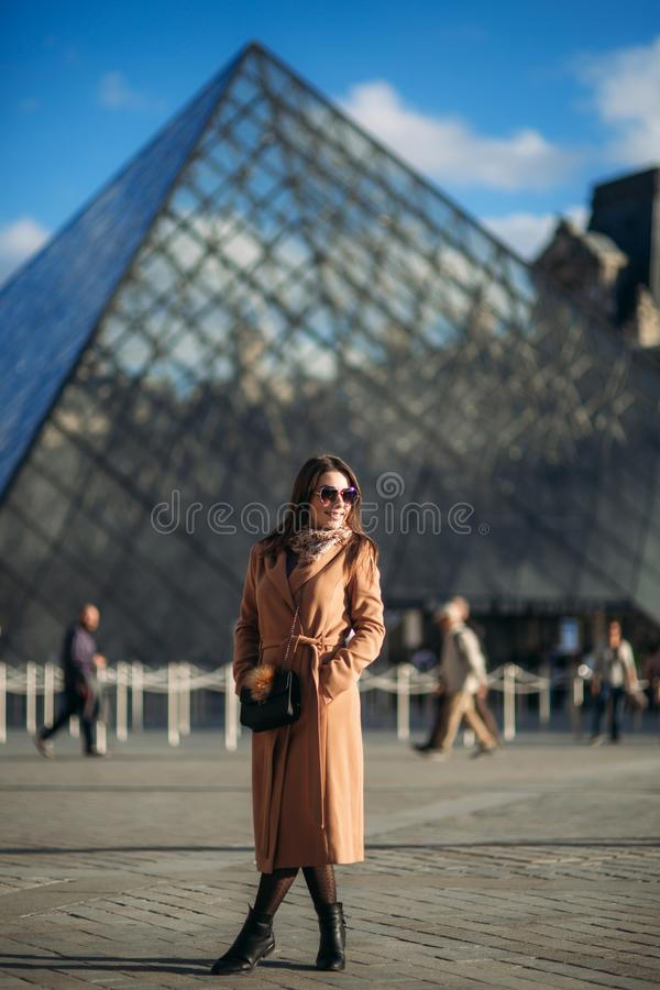 Beautiful model walk in centre of the city. Fashion madel poses to photographer stock photo
