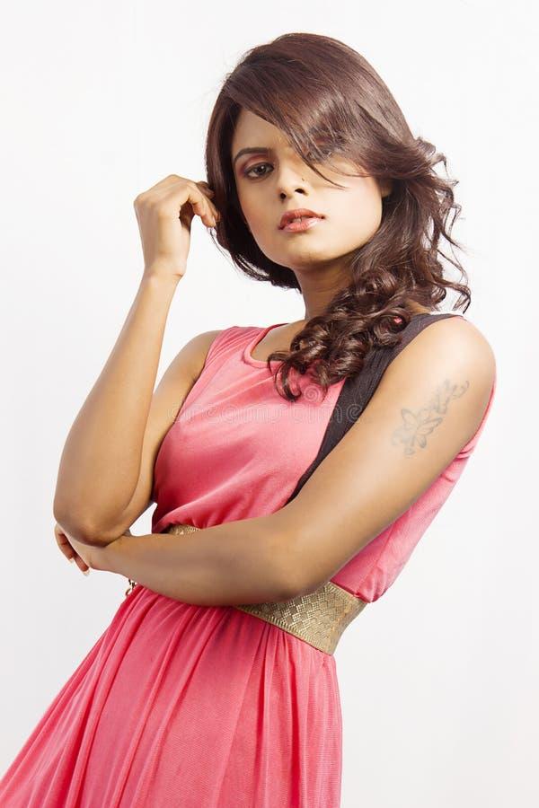 Beautiful model wearing a pink skirt royalty free stock photos