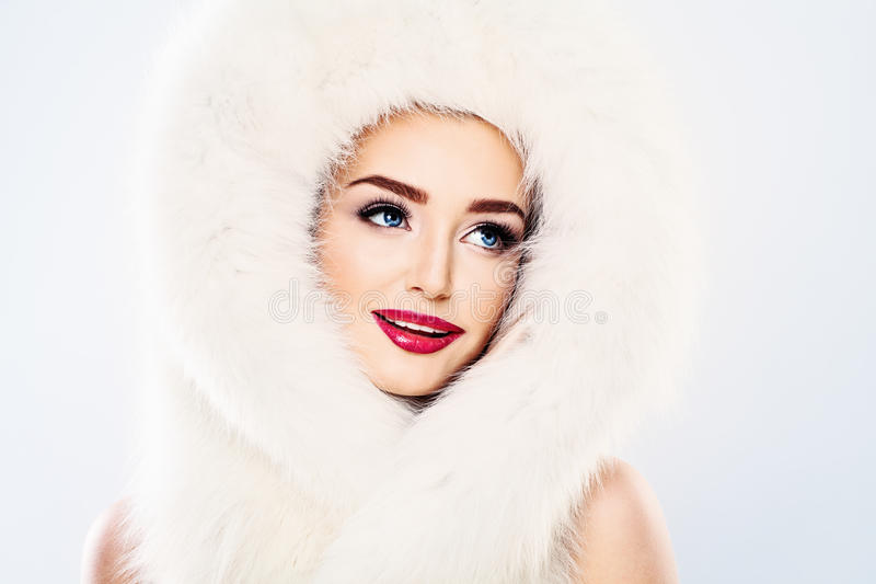 Beautiful Model Woman with Makeup and Winter Fur royalty free stock images