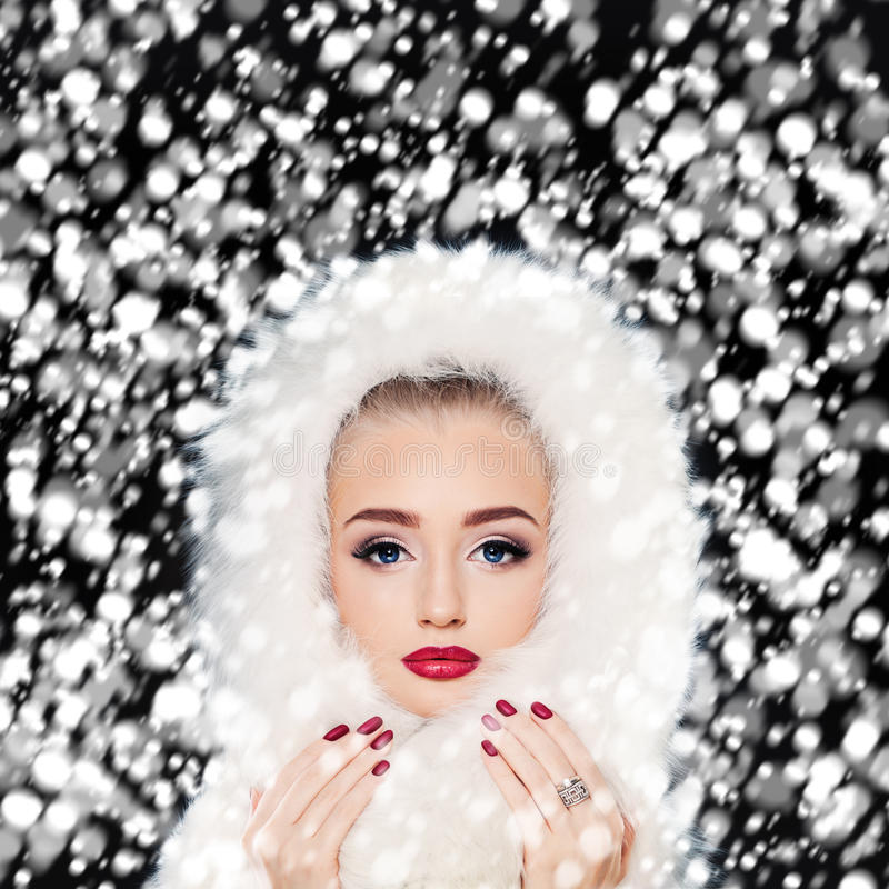 Beautiful Model Woman with Winter Snow. Makeup and Manicure royalty free stock image