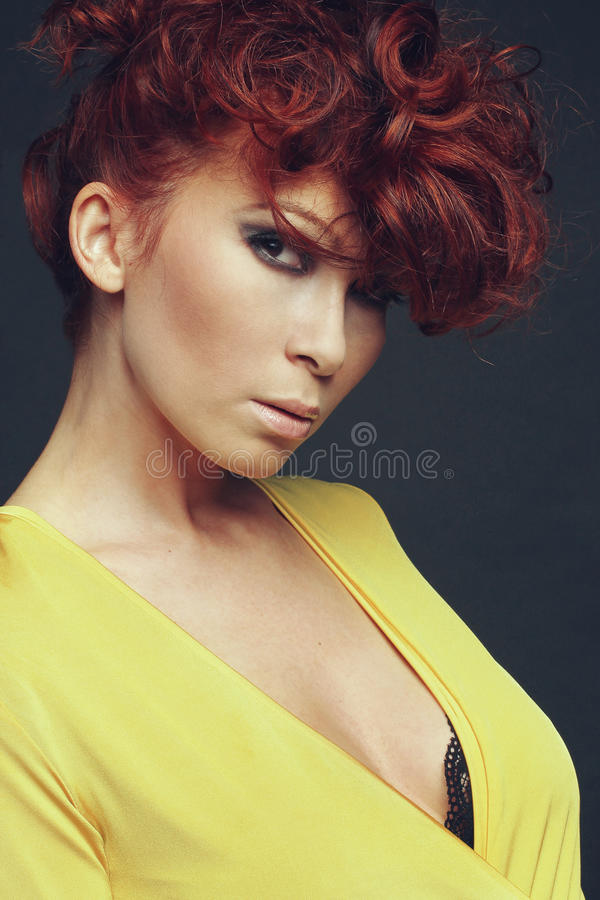 Beautiful model in yellow dress. stock photo